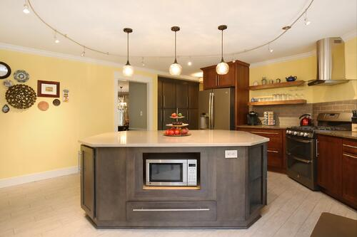 Got Stuff? Try floor to ceiling cabinets!